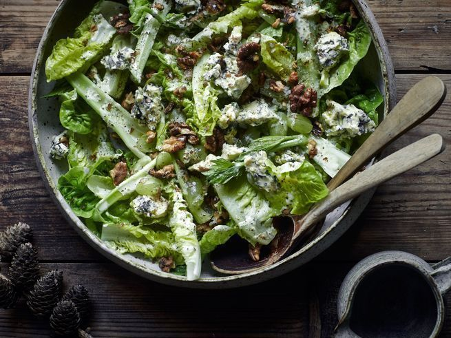 Sweetly acidic green grapes off-set the funk of creamy Danish blue cheese in this seasonal salad tossed together with a creamy cider vinegar–walnut dressing.