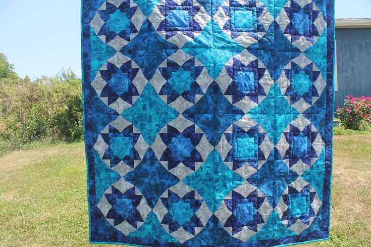Pinwheelskaleidoscopequiltcolorfulfree-motionblanketthrowboundless batik collectionhalf-square triangles