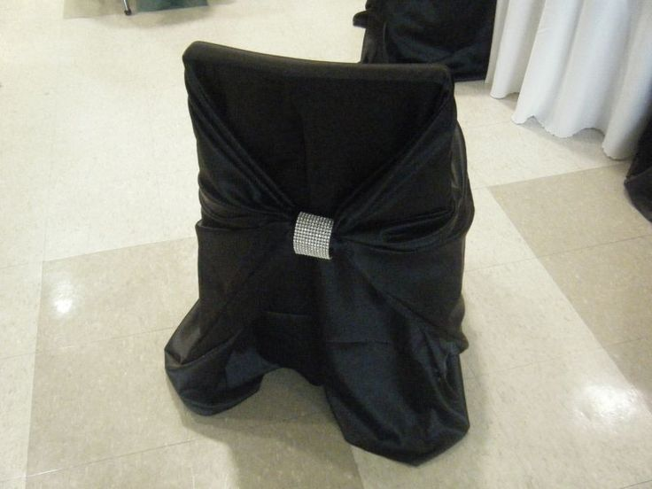Black Satin Chair Cover. The Satin Chair Covers are actually a Wrap.  This enables this cover to fit a wide variety of chair sizes.  The Clasp on the back comes in either silver or gold (add .50).