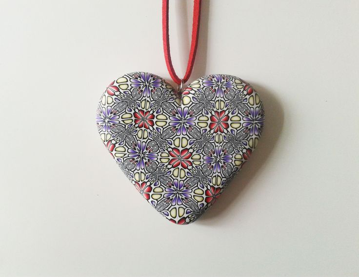 handmade polymer clay heart pendant decorated with kaleidoscopic pattern