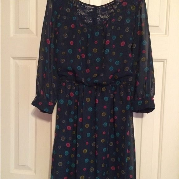 Dark Blue long sleeve dress Dark Blue long sleeve dress; button print; button down back; top back part is lace; worn twice Dresses Long Sleeve
