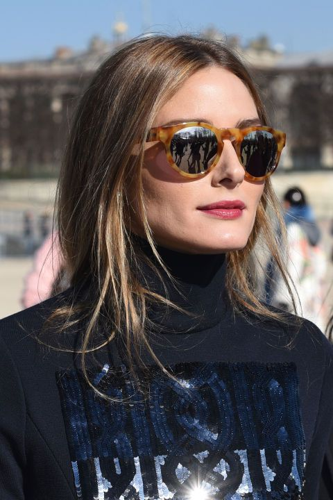 Olivia Palermo's undone chignon, a rose-stained pucker, and oversized sunnies.