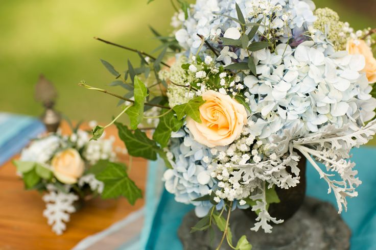 Registration Table with Blue Hydrangea, Baby Breath & Peach Rose - posy