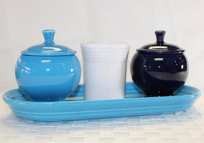 Bathroom Fiesta - Colorful and fun way to brighten up your bathroom with fiestaware and now with the new Fiesta lotion dispenser it is even easier to put together a bathroom ensemble. Shown: Bread tray, tumbler, covered sugar. Find these Fiesta items and more at http://DinnerwareUSA.com