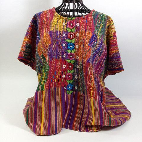 This is a very beautiful, hand woven then embroidered huipil, or over blouse, woven and worn by a Mayan woman in the state of Chiapas. The heavy cotton striped background is complimented by the bright colors of orange, yellow, red, and green. The colors combine beautifully. It's not fitted so