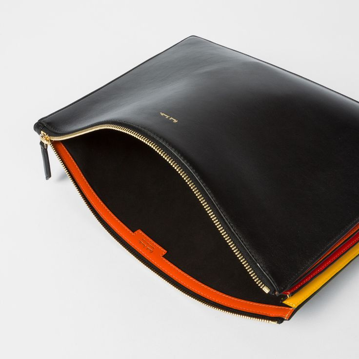 Men's black 'Concertina' document pouch featuring contrasting yellow, red and orange pleats at the side, giving a striped effect.