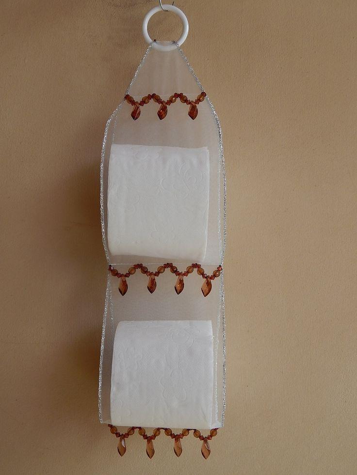 Porta papel higiênico em tule para duas unidades de papel.  *Foto ilustrativa