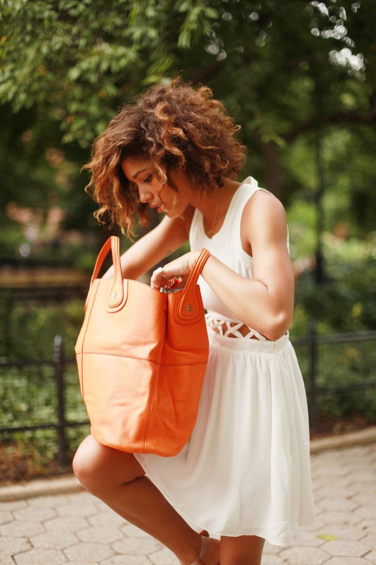 Trop Rouge's Christina Caradona styles the Givenchy tote.