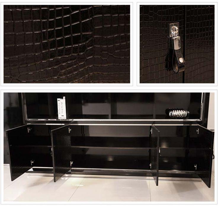 Покрытие и открывающиеся дверцы книжного шкафа черного цвета из МДФ, более подробно на сайте магазина https://lafred.ru/catalog/catalog/detail/41502256243/
