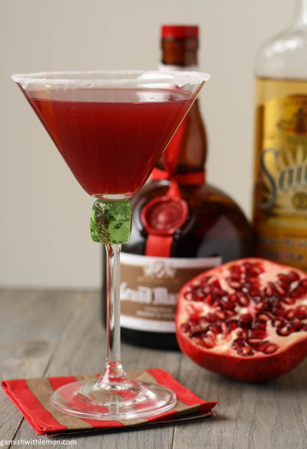 Pomegranate Tequini  2 oz. Tequila 1 oz. Pomegranate juice ¾ oz. Lime Juice ¾ oz. Grand Marnier Splash of Grenadine Superfine sugar and lime wedge for rim