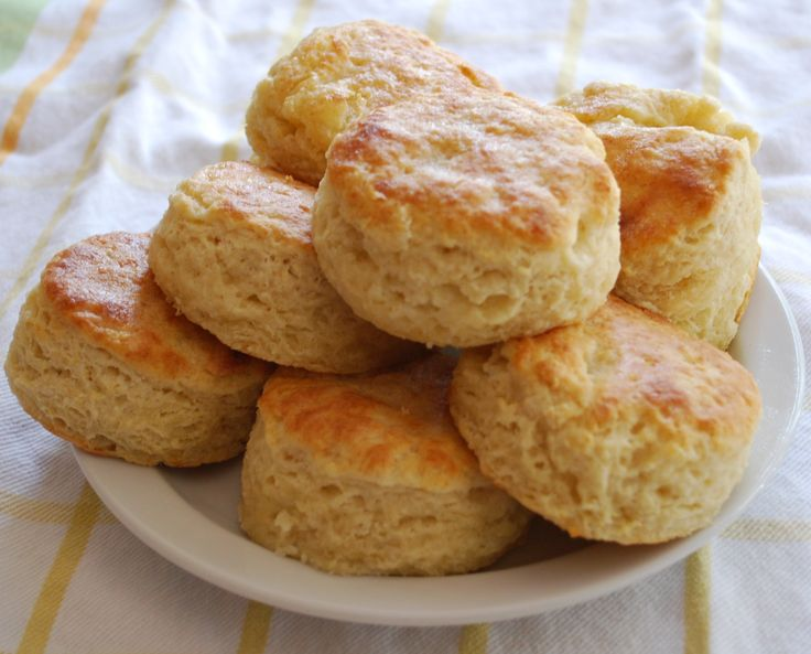 Biscuit recipe using oil.  Turns out light and fluffy!  Top with melted butter.