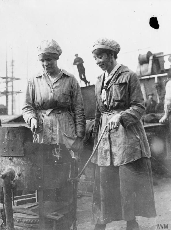 Female workers heat rivets in a portable furnace at Harland and Wolff shipbuilding yard, Clydebrae Street, Govan, Glasgow.