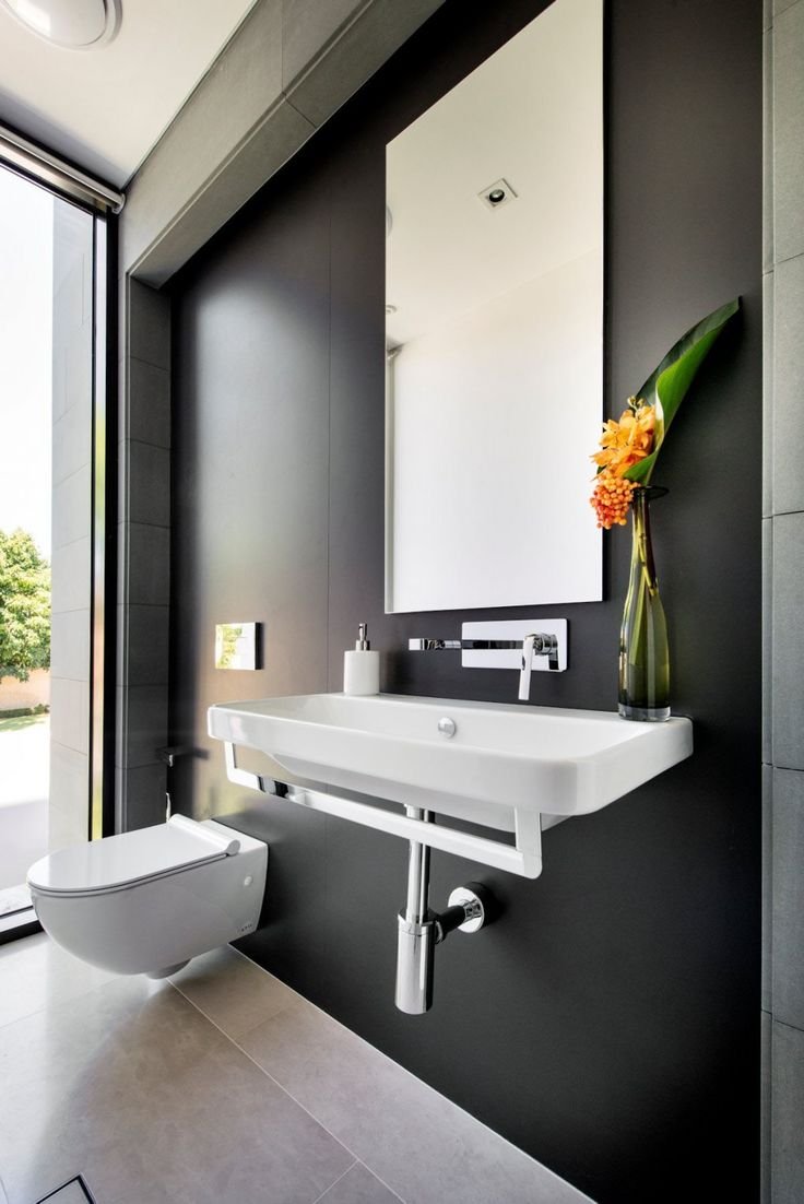 architecture white modern toilet and white sink bathroom faucet single hole mirror bathroom black wall: architecture bathroom toilet