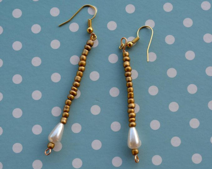 Simple gold bead long earrings, dangle & drop with a small pearl in the bottom.    https://www.etsy.com/shop/Aamapola    #etsy #earrings #handmade #beads #pearl #gold #golden #simple #chic #fashion #style #readytowear #2017 #fashion2017 #present #2018 #Spain #woman #accessories #trendy #cute #shop #blogger #dangle #drop #aretes #pendientes #artesanales #madeinSpain