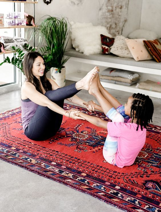 Get playful at home with these 6 partner yoga poses that can be done with your kids.