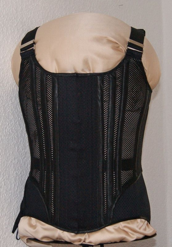 Men's corset with shoulder straps This elaborate corset (S-line) has been especially designed for the warmer season. Despite the air-permeable lattice inserts (without lining), the necessary tensile strength is ensured by an extra-wide and reinforced waistband without adversely affecting wearing comfort.  * Flexible straps (very sturdy rubber), additionally adjustable by means of folding slider * concealed corset clasp