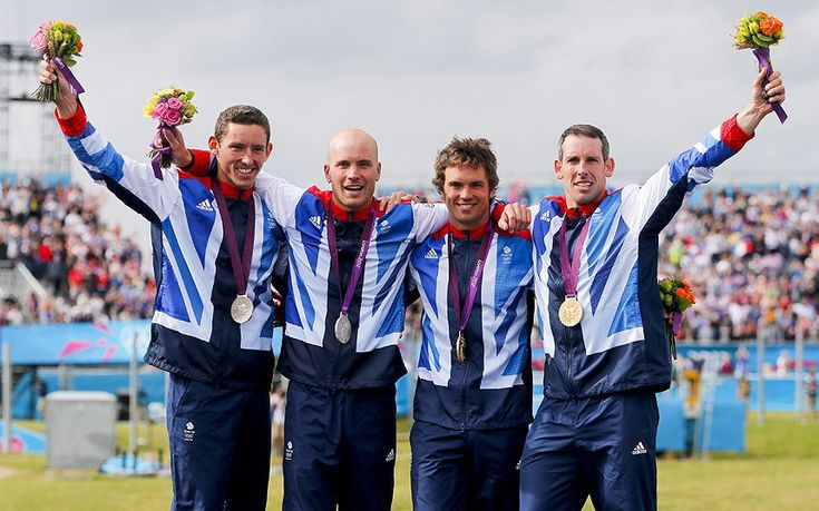 What a team: Silver medalists David Florence and Richard Hounslow celebrate with gold medalists Tim Baillie and Etienne Stott during the medal ceremony for men's canoe double