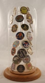 The dome design glass made coin display case will hold 46 military challenge coins.