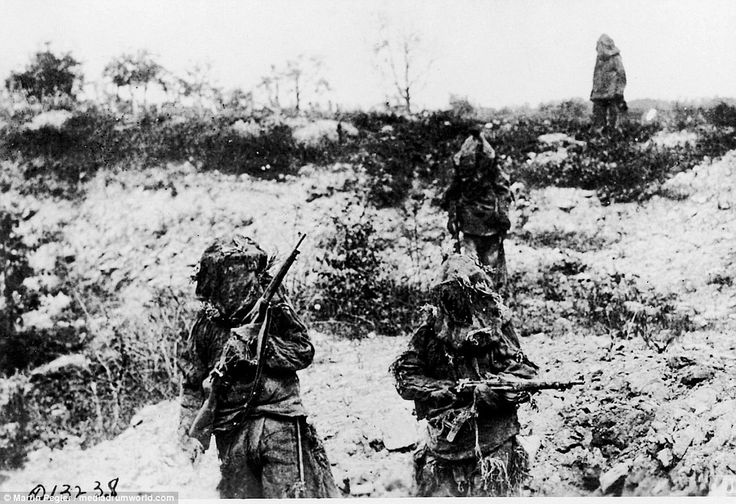 US Army snipers in full Ghillie suits advance across typical chalk Somme terrain. Their Springfield M1903 rifles are wrapped in Hessian and camouflage painted, but the scopes have been dismounted, probably to prevent damage while training