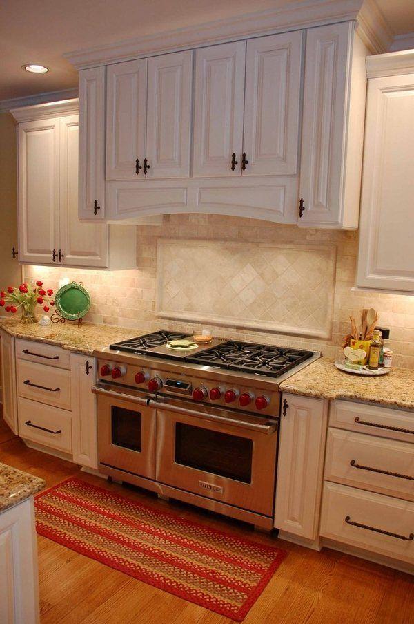 new venetian gold granite countertops travertine backsplash white kitchen cabinets wood flooring area rug