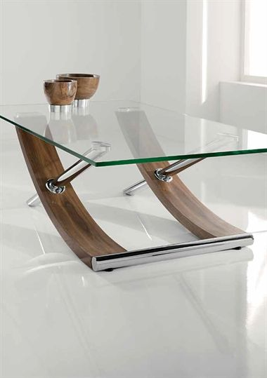 Tusk.  The Tusk range of glass topped occasional tables from Chelsom effortlessly combines classic and modern materials. Finished with a tempered glass top, the gently curving walnut veneer legs are cleverly bisected by chrome tubing, offering a design that is both striking and elegant.