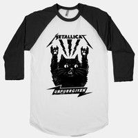 Metallicat sleeps with one eye open, gripping his pillow tight, rides the lightning to the litterbox