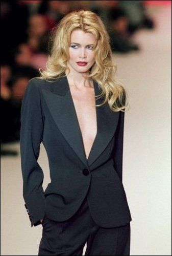 Claudia Schieffer with the famous YSL smoking, who can transform herself from a mildly pretty, very blonde woman into a smoking-hot bombshell.