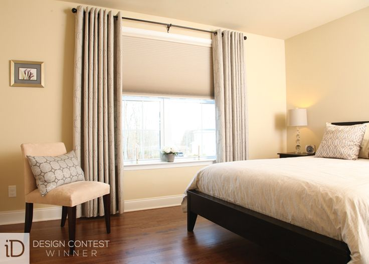 Room-darkening cellular shades and linen drapes help block sunlight and allow guests to receive a good night's sleep.