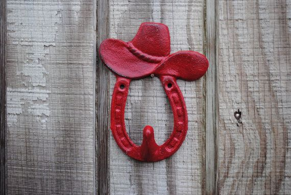Engine Red Cowboy Hat Wall Hook/ Horseshoe/ Nursery Accent/ Country/ Western Theme/ Distressed Cast Iron Hanger/ Painted/Rustic/Lodge. $9.49, via Etsy.