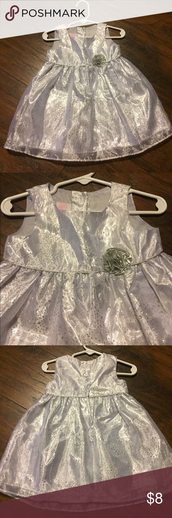 La Princess 12 month silver dress Adorable La Princess 12 month silver dress. Excellent condition as it was worn once for Christmas pictures. Both the dress and the lining  are 100% polyester. There is a sheer layer over the metallic layer. The dress has a three-dimensional flower on the front and three button closure in the back. La Princess Dresses