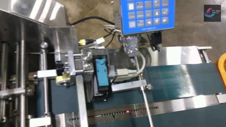 MiniKey HSAJet TIJ Printer installed with Label Feeding System for sewin...