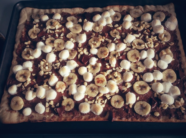 Chocolate pizza topped with crunchy walnut, banana, and marshmallow