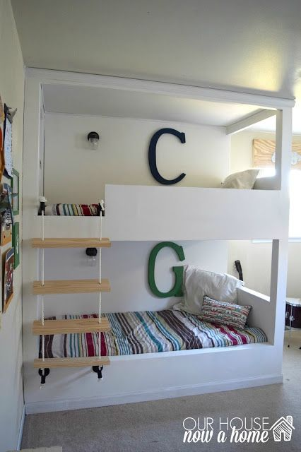 One room challenge, - Week 6, Boy bedroom reveal. DIY built in bunk beds in boy bedroom with a transpiration theme. A rope ladder, rustic elements with bright colors makes this room fun for the two boys sharing this bedroom. To see more visit- http://www.ourhousenowahome.com/