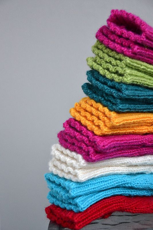 Pile of colourful mittens by Lankatarina.