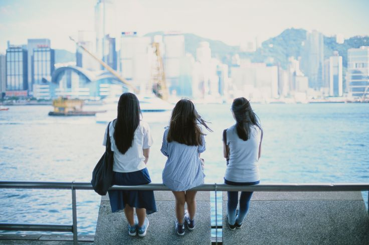Three girls looking at the harbour
