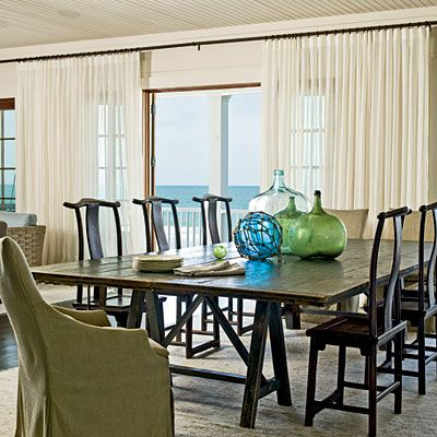 Slipcovered Seating  Linen covers on the host and hostess chairs add an earthy, organic tone to the beachy palette...blues and greens with cream