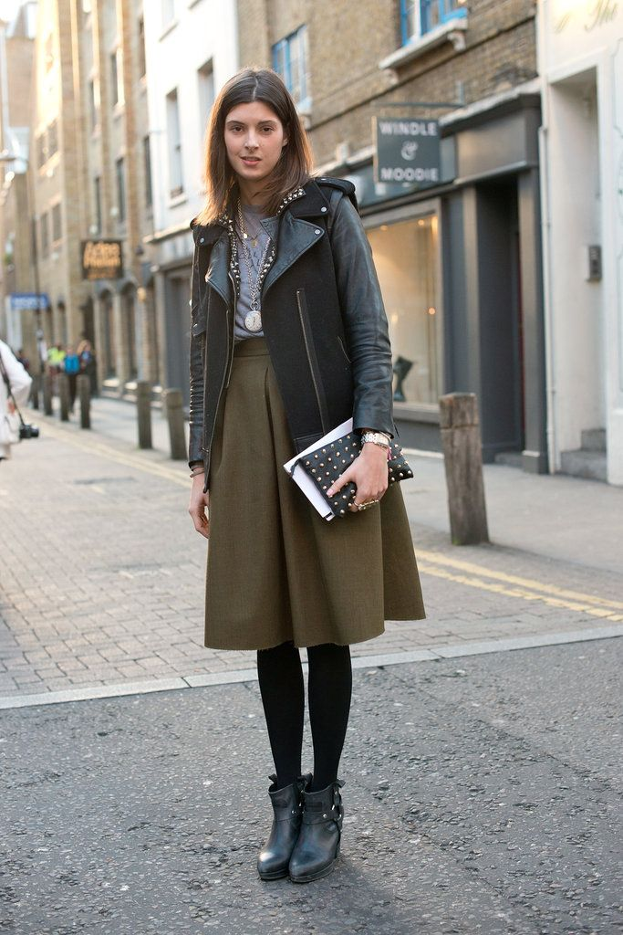 A girlie skirt got a tougher edge with a leather jacket and harness ankle boots.