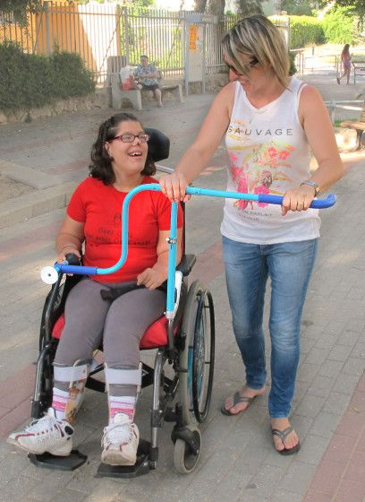 The Wheelchair Extension Lets Daughter and Mother Walk Side By Side