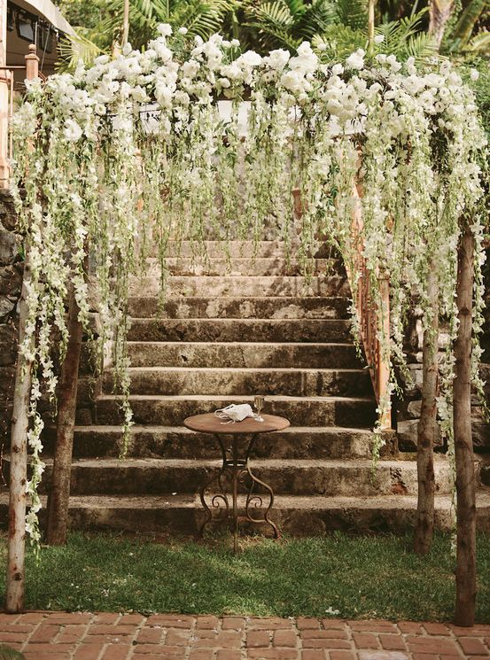 "Above the ""head"" table we'll have a hanging centerpiece with eucalyptus and dendrobium. - provided by Williams"