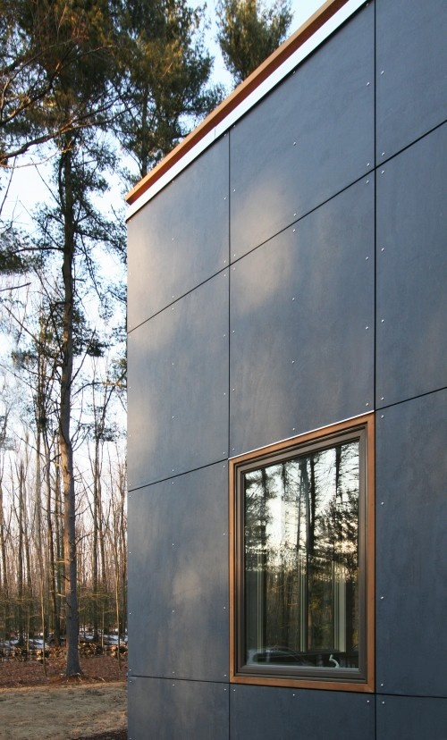 cement board panels, galvalume metal, black steel cladding