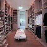 Luxurious Walk in Closet Design Ideas with Wooden Floors and White Bench