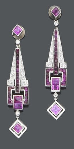 A pair of Art Deco ruby  diamond pendant earrings, ca 1925.  Each French-cut ruby suspending a tapering articulated drop set with French  calibré-cut rubies  single-cut diamonds, terminating with a French-cut ruby swing drop, length 4.3cm., fitted case by Johnson Walker Tolhurst.