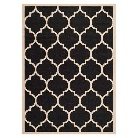 Add a sense of contemporary elegance to your living room or conservatory with this power-loomed rug, featuring a quatrefoil pattern in black and beige. Suita...