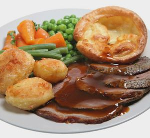 Classic British food - roast beef and Yorkshire pudding. Has to have cabbage and beef gravy.