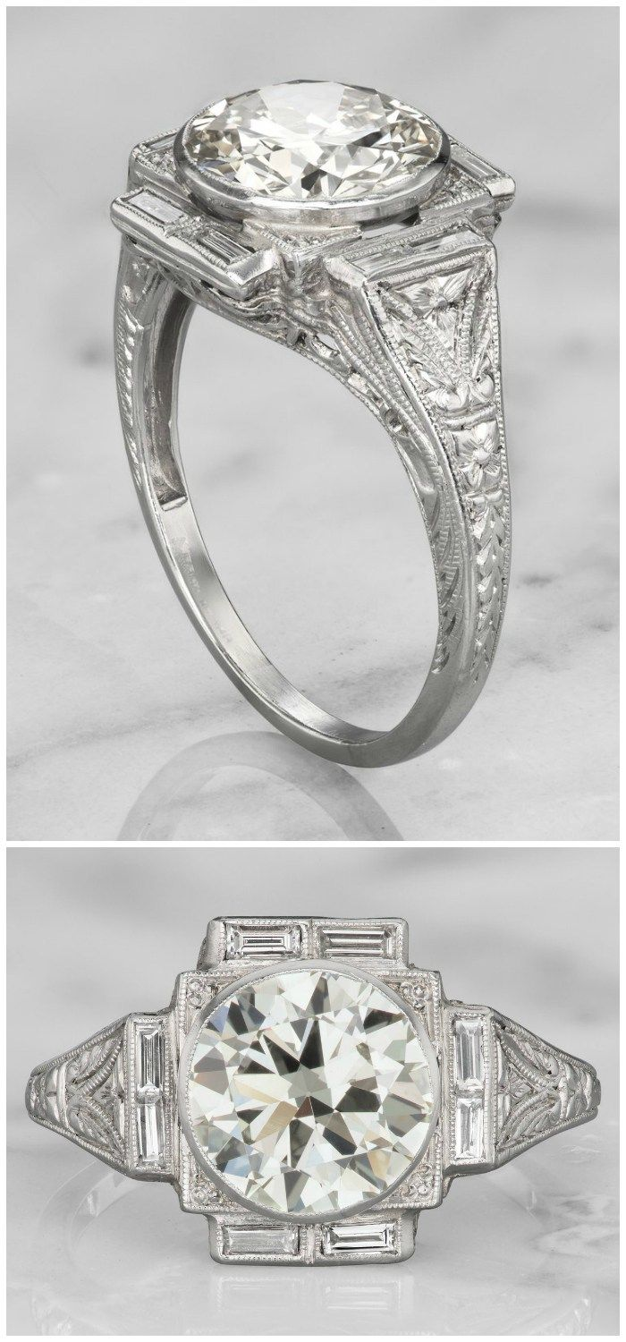 A wonderful Art Deco era vintage engagemnet ring with a 2.23 carat diamond in a platinum bezel setting.