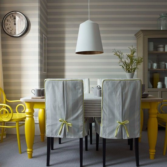 Grey striped dining room with yellow accents...