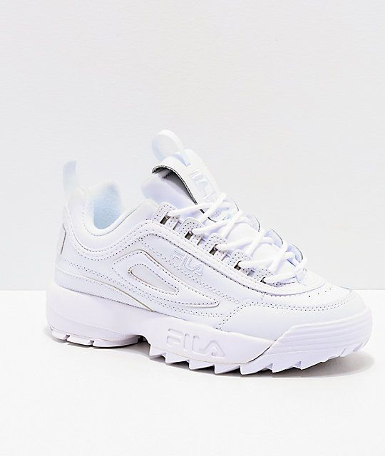 ef3a5c0649cf Elevate your athletic style in the Disruptor II Premium All White Shoes  from FILA. Coming in a crisp