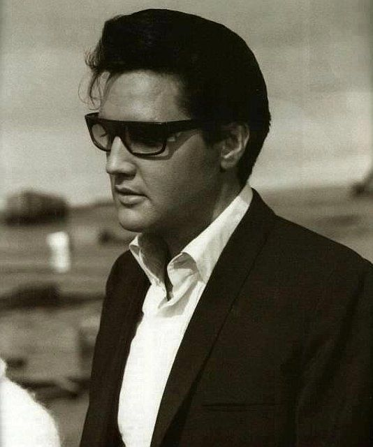 Elvis...Looking So Sexy In Shades, White Shirt Open & A Dark Suit...Wow...No Wonder the Ladies Screamed...