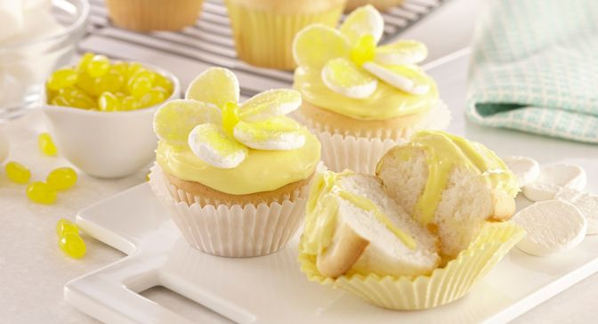 Brighten up your springtime celebrations with a batch of daisy cupcakes. They're as fun to make as they are to eat.