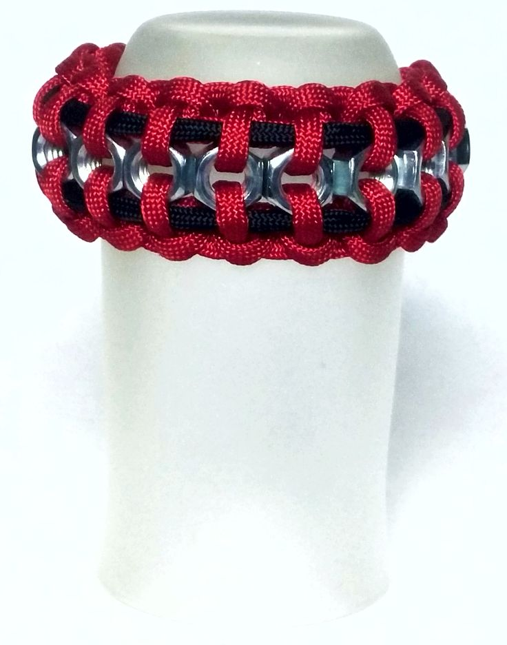 """Buy Hexnut Paracord Bracelet This clean and casual piece displays the 5/16"""" hex nuts by taking advantage of simple contrast. Notice how the two contrasting colors frame the intricate workings of this"""